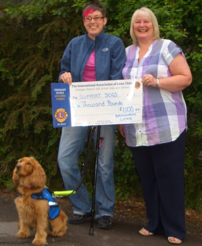 Sylvi with Cassie, her Support Dog, accept a cheque for £1000 for Support Dogs from Lion President Helen, June 2010